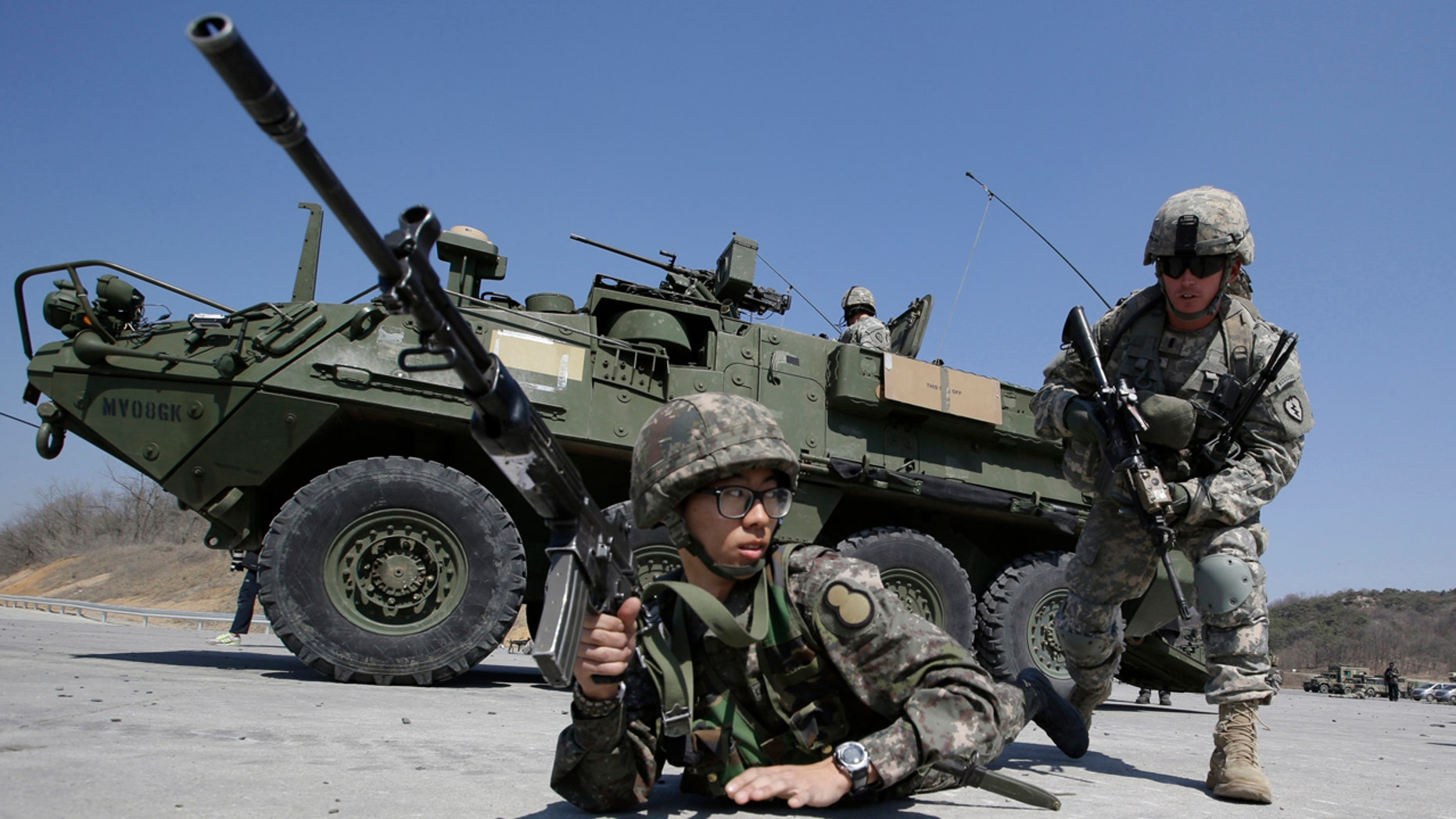 In this March 25, 2015, file photo, U.S. Army soldiers from the 25th Infantry Division's 2nd Stryker Brigade Combat Team and a South Korean Army soldier participate in a demonstration of the combined arms live-fire exercise during the annual joint military exercise Foal Eagle between South Korea and the United States at the Rodriquez Multi-Purpose Range Complex in Pocheon, north of Seoul, South Korea. (AP Photo/Lee Jin-man, File)