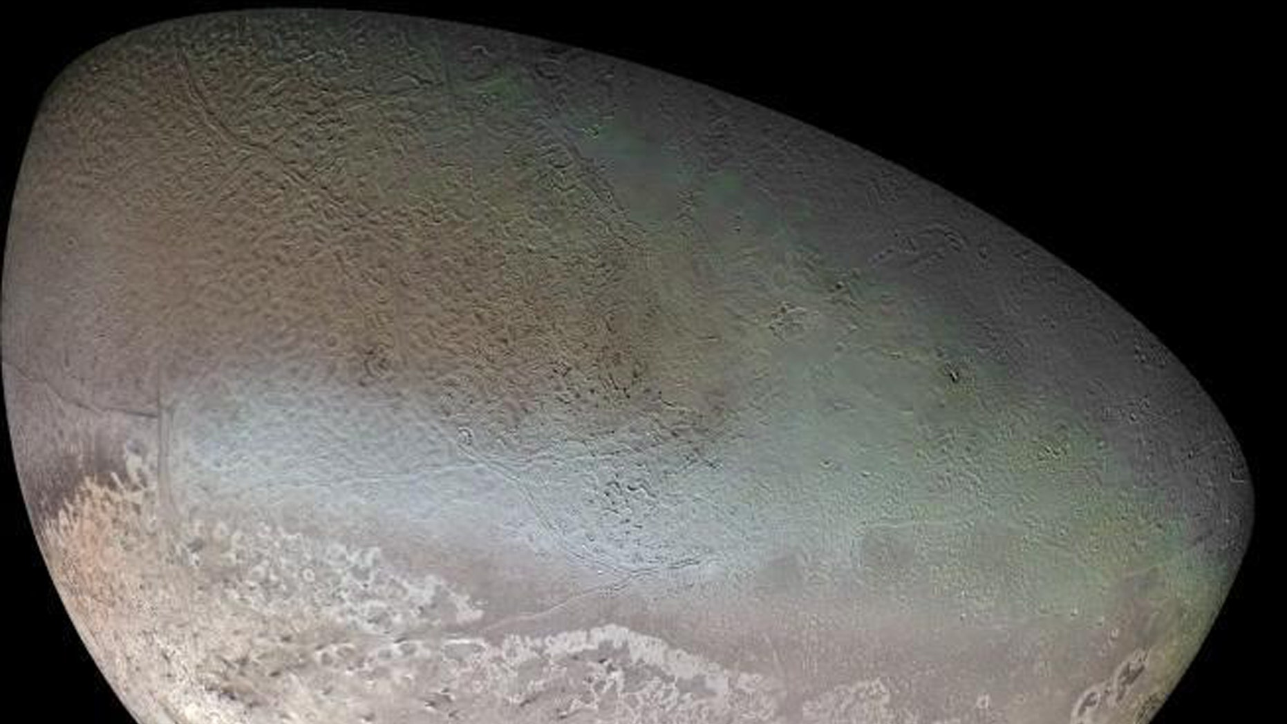 Global color mosaic of Triton, taken in 1989 by Voyager 2 during its flyby of the Neptune system. (Credit: NASA/JPL/USGS)