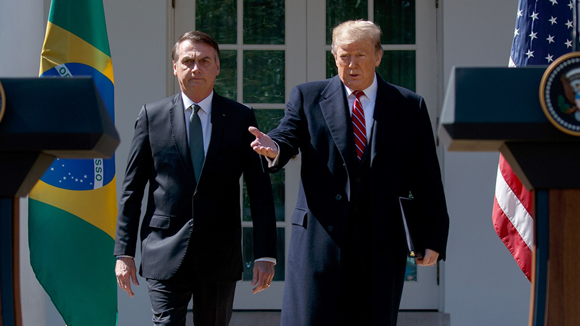 President Trump and Brazil's new far-right leader, President Jair Bolsonaro, arranged to sign several bilateral agreements, including one that allows the United States to use Brazil's Alcantara Aerospace Launch Base for its satellites. (AP Photo/Evan Vucci)