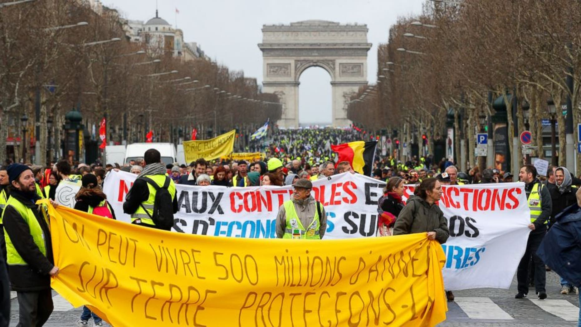French Yellow Vest protesters gather at the Arc de Triomphe in Paris, Saturday, March 9, 2019. It was the 17th straight weekend of protests in Paris and other cities against the government's economic policies, which are seen as favoring the rich..