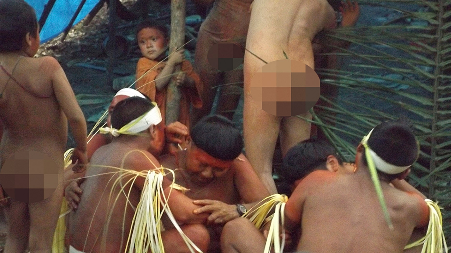 This undated 2014 handout photo released by Brazil's National Indian Foundation, FUNAI, shows members of the Korubo tribe in the Javari Valley, in the northern state of Amazonas, Brazil.