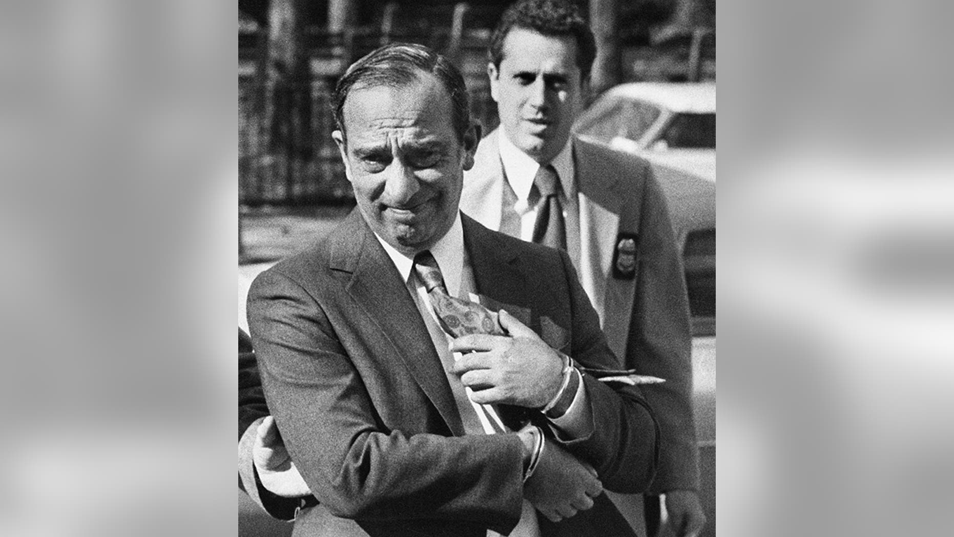 Photo shows Colombo crime family boss Carmine Persico as he was led into court in handcuffs in New York in 1980. (New York Post via AP)