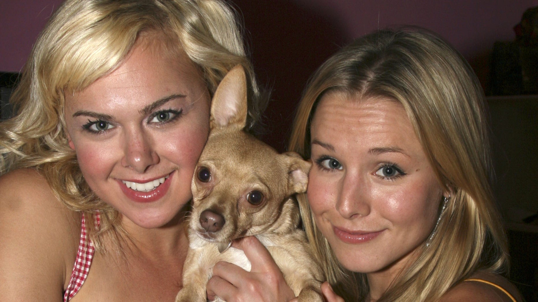 Laura Bell Bundy and Chico the Chihuahua pose with Kristen Bell as she visits Legally Blonde on Broadway at The Palace Theater in July 2007.