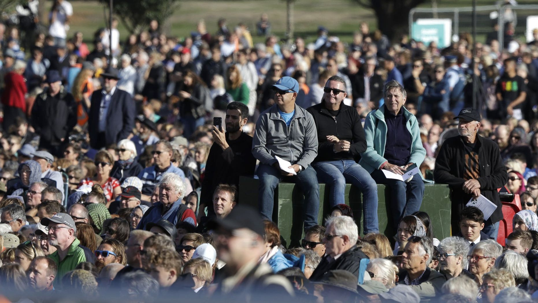 People listen during a National Remembrance Service in Hagley Park for the victims of the March 15 mosques terrorist attack in Christchurch, New Zealand, Friday, March 29, 2019.