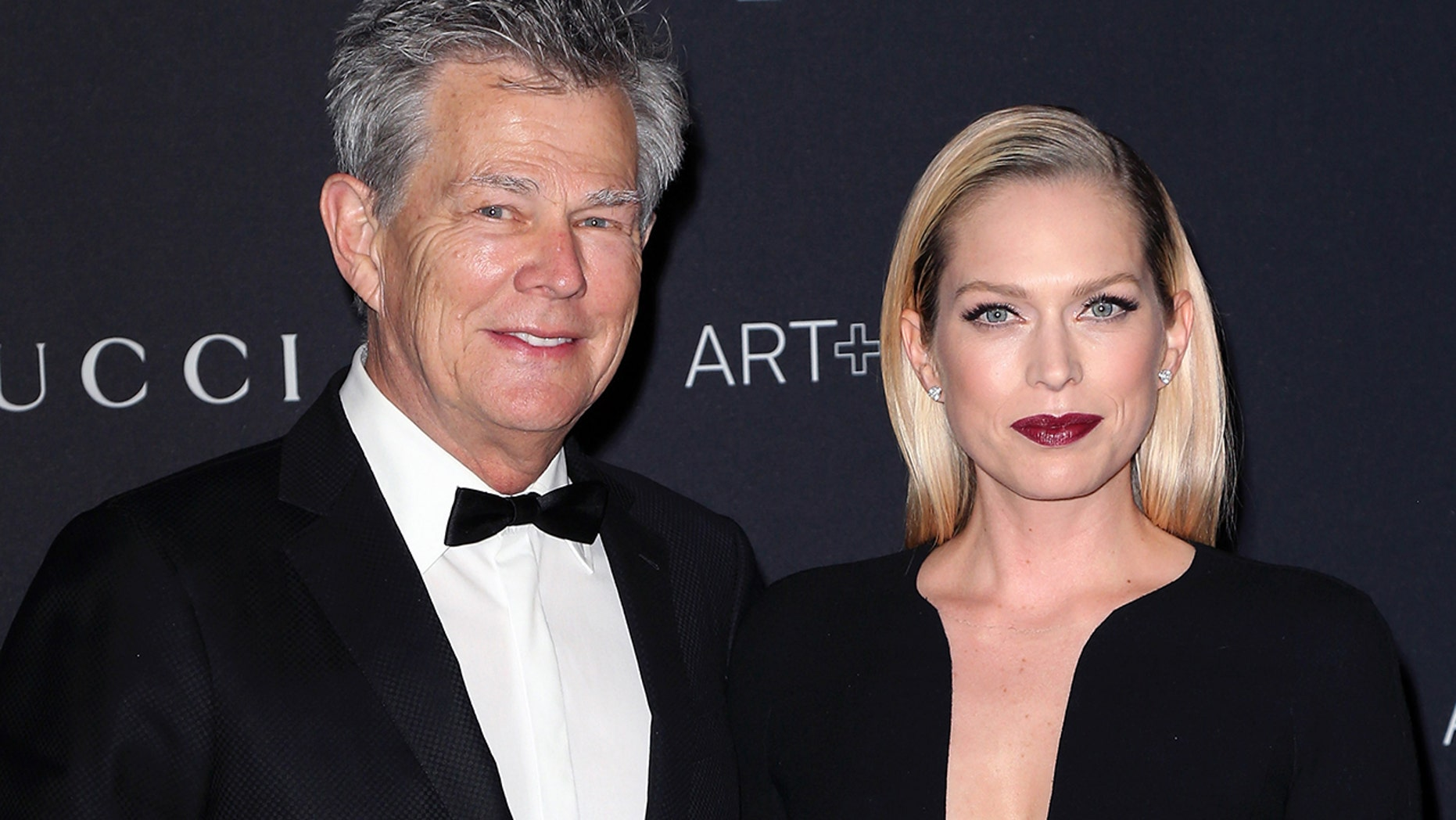 FILE 2015: Composer David Foster (L) and Erin Foster attend the LACMA Art + Film Gala in honor of Alejandro G. Iñárritu and James Turrell and are presented by Gucci in Los Angeles. (Photo by David Livingston / Getty Images)