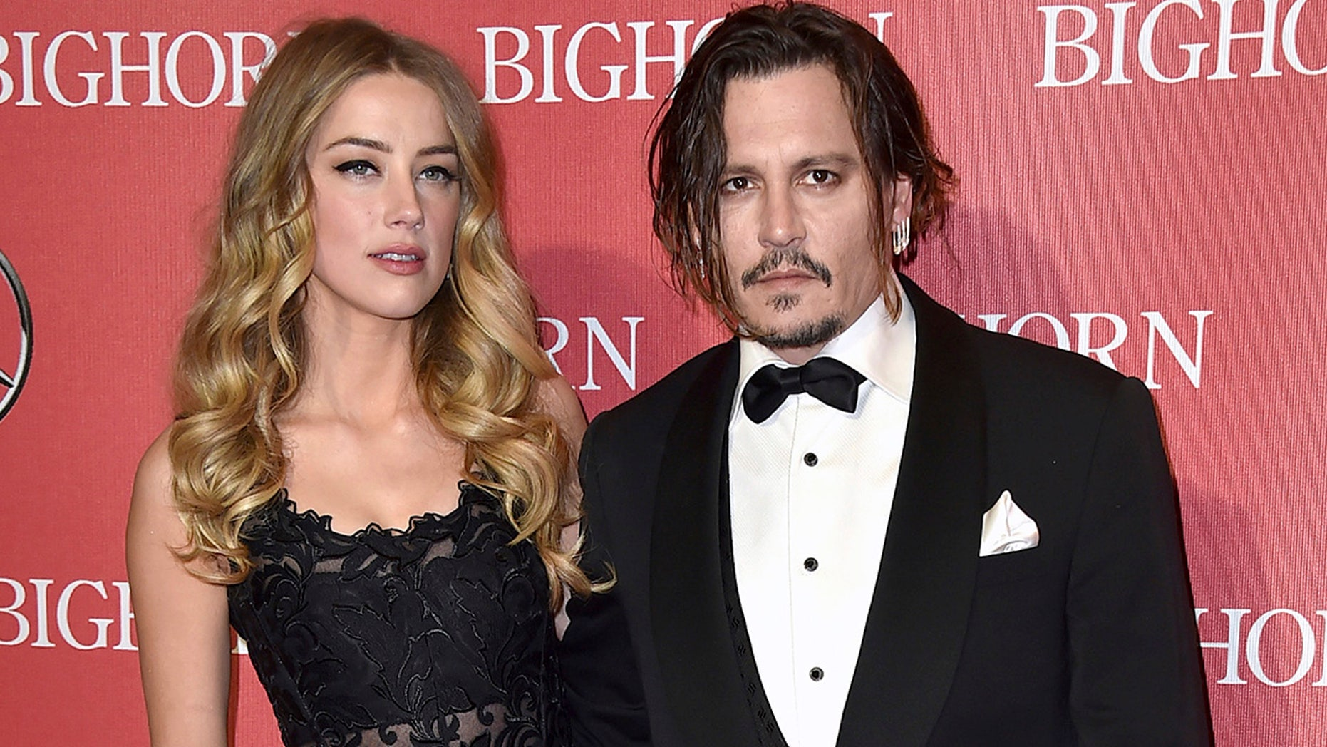 Amber Heard, and Johnny Depp arrive at the 27th annual Palm Springs International Film Festival Awards Gala in Palm Springs, Calif., Jan. 2, 2016. (Associated Press)