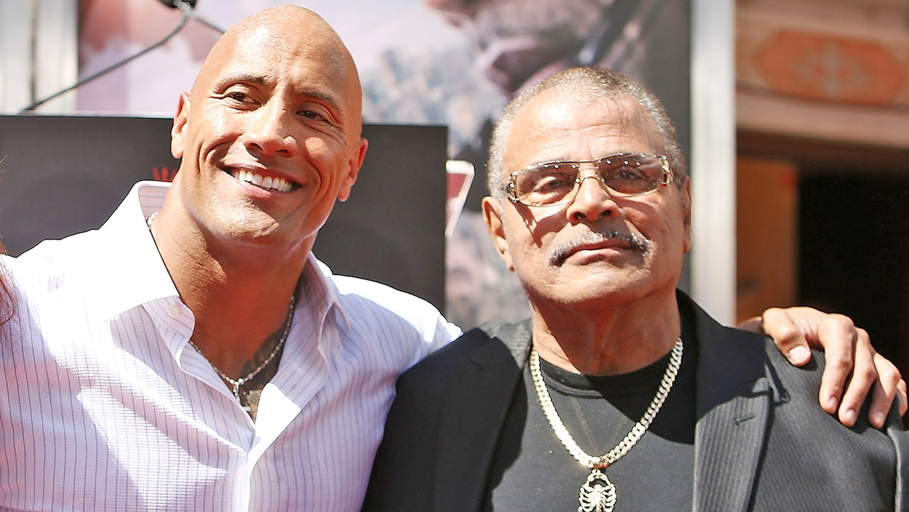 "Dwayne ""The Rock"" Johnson and his father, Rocky Johnson"