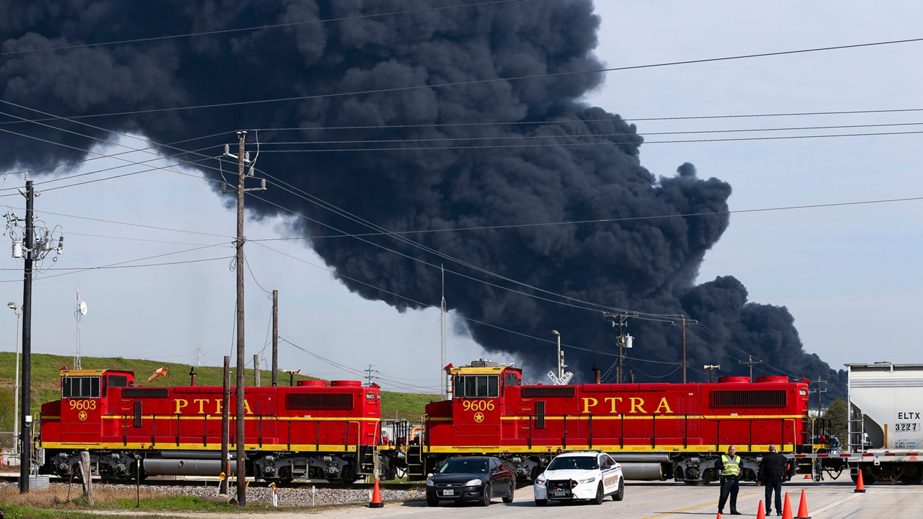 Firefighters battling the petrochemical fire at Intercontinental Terminals Company, which grew in size due to a lack of water pressure earlier this week in Deer Park, Texas. (Godofredo A. Vasquez/Houston Chronicle via AP)