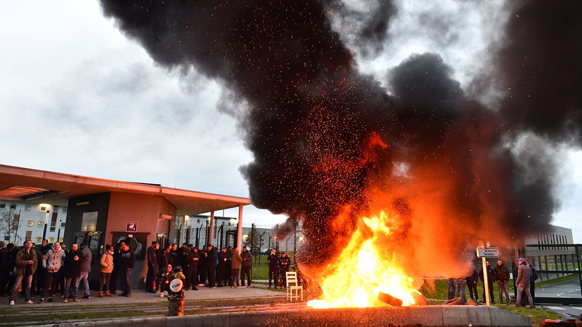 "The entrances to 18 prisons in France were blocked by guards who burned tires and other materials at the gates in protest of the stabbing of two colleagues at a jail in northwest France which is being described as a ""terrorist"" attack"
