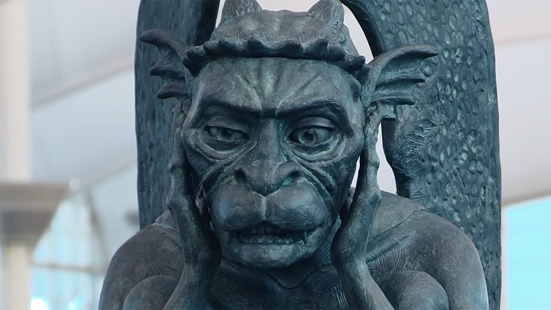 The airport shared footage of the chatty gargoyle surprising passersby to YouTube, where it has since gone viral with over 70,000 views.