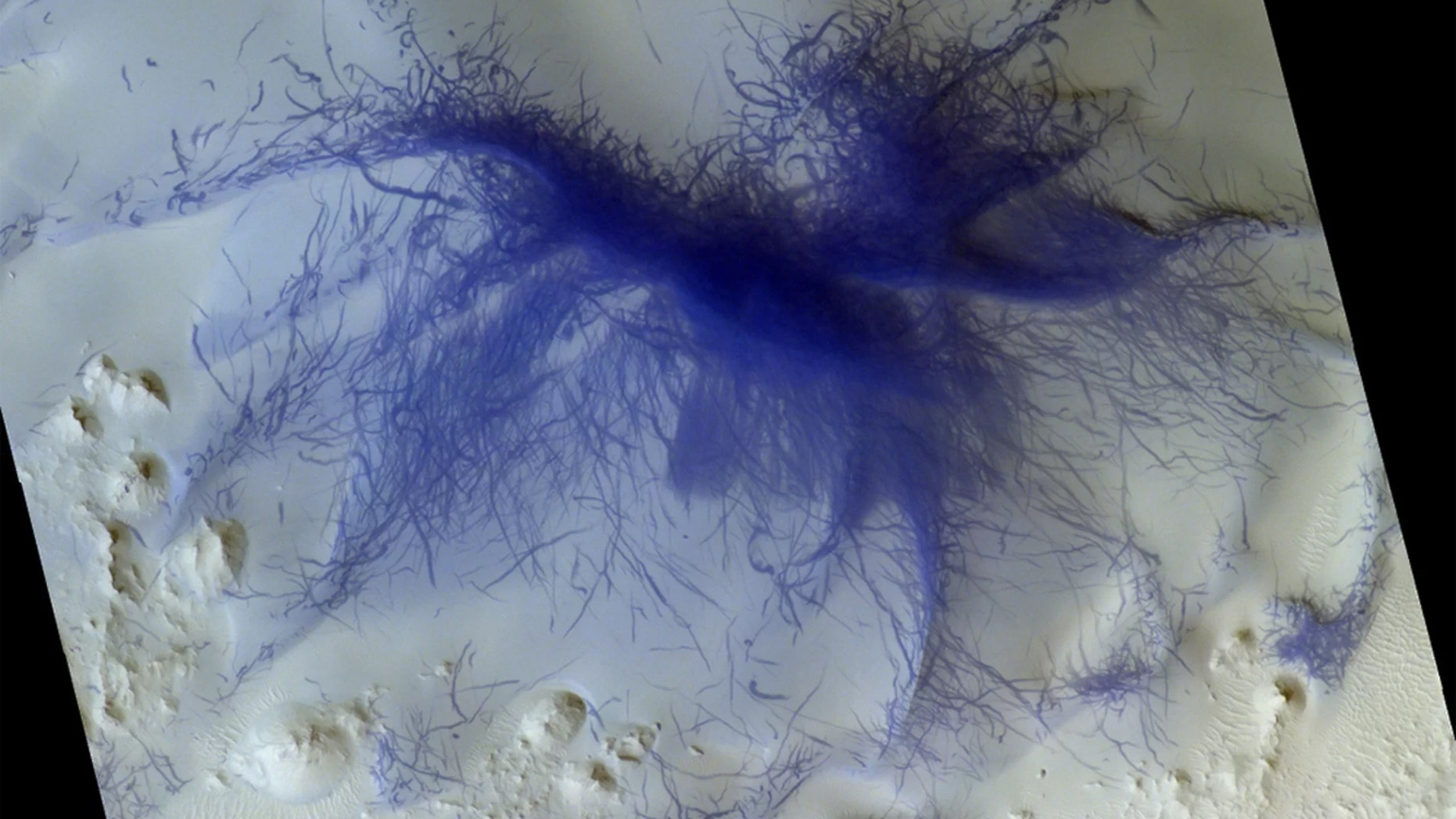 A feature on Mars that looks like a very hairy spider was likely caused by the convergence of hundreds or even thousands of tornadoes. (Credit: ESA/Roscosmos/CaSSIS, CC BY-SA 3.0 IGO)