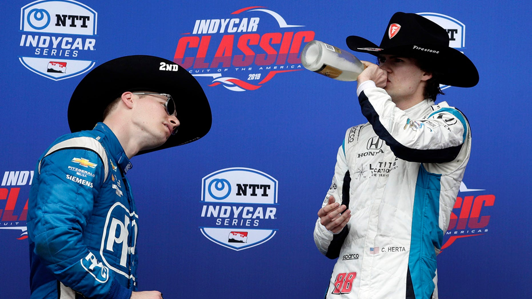 Runner-up Josef Newgarden checked the label on Herta's bottle when he saw him take a drink.