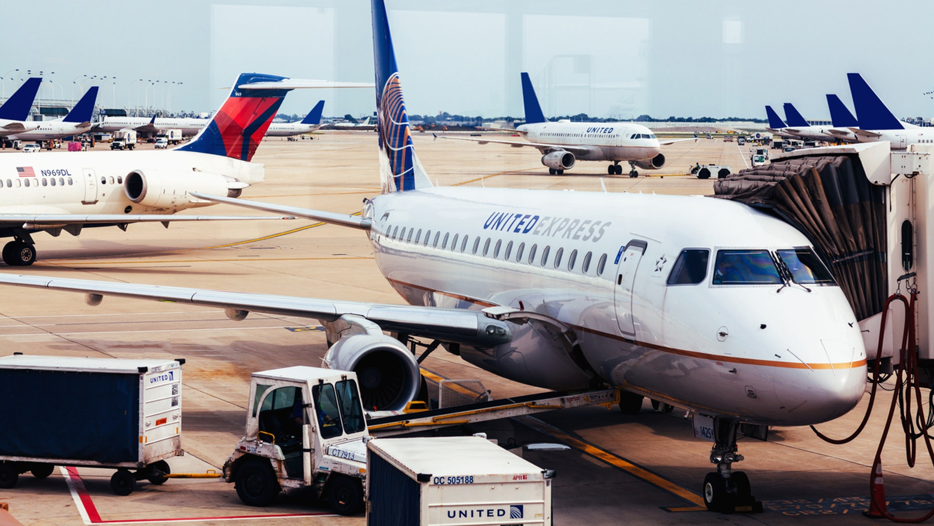 A pilot on a Mesa Airlines flight operated by United Express did his best to put wind back in his passengers' sails after a delay of more than two hours.