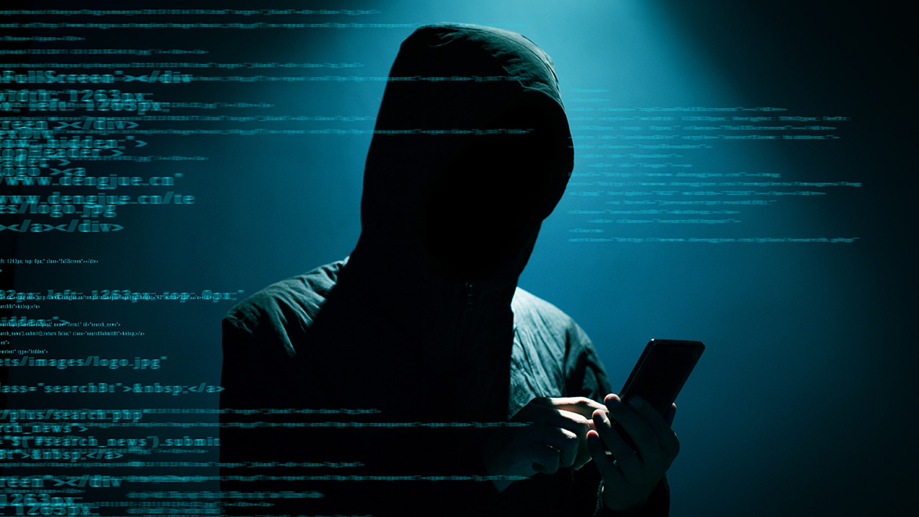 Hacker Hacker using phone at dark (Credit: iStock)