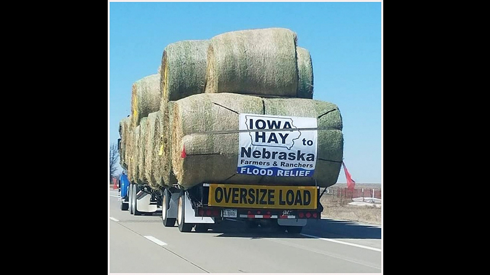 """The large semi truck with the caption """"Iowa Hay to Nebraska Flood Relief"""""""
