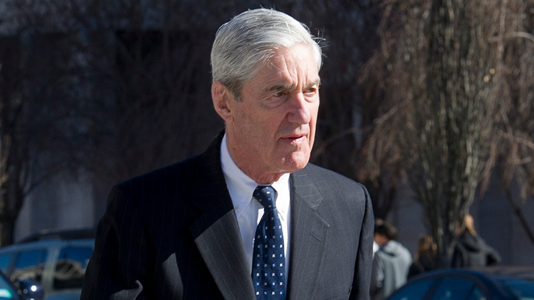 Special Counsel Robert Mueller walks to his car after attending services at St. John's Episcopal Church, across from the White House, in Washington, on Sunday.