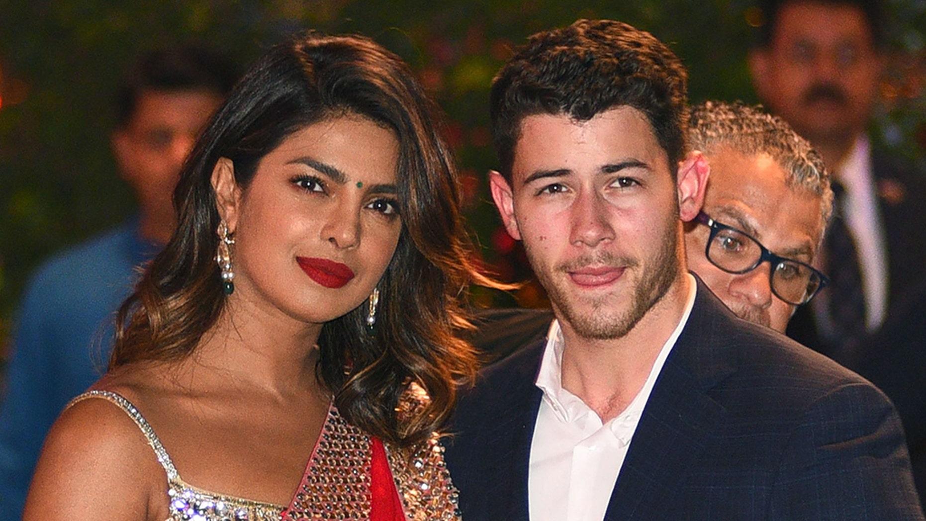 Indian actress Priyanka Chopra (L) and husband Nick Jonas.