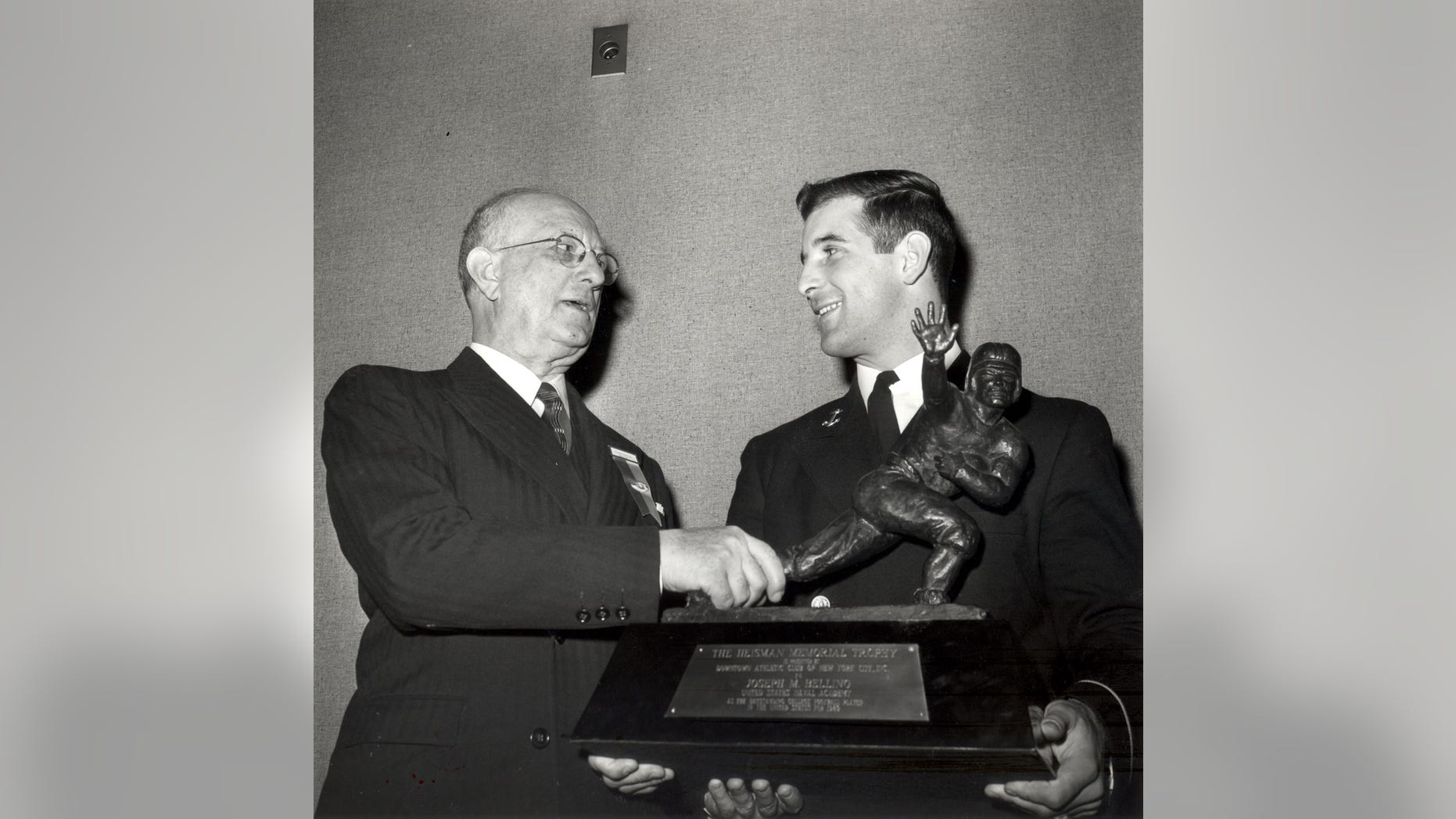 Joe Bellino is presented the Heisman trophy in 1960. The Naval Academy's star halfback was the first player to receive the award. Bellino passed away Thursday at 81.