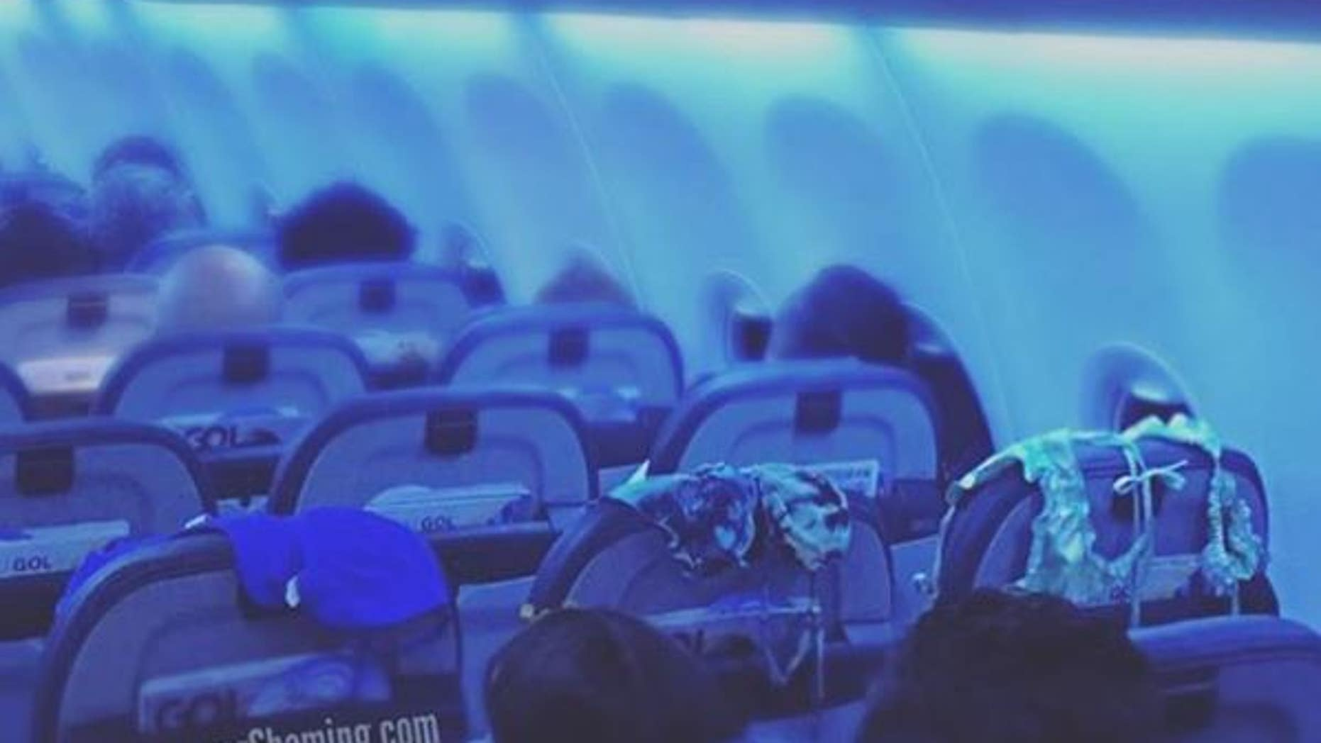 A passenger was caught using the back of three seats to air out three different swimsuits.