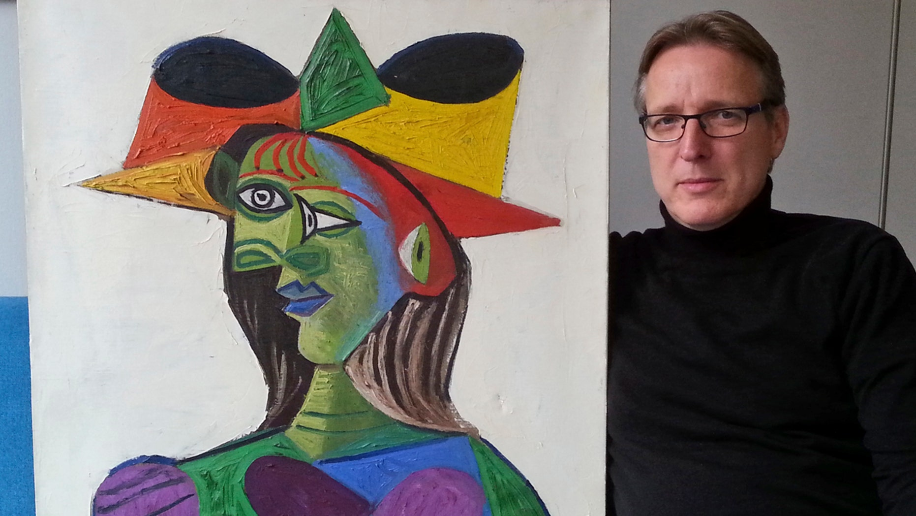 "This image released on Tuesday March 26, 2019 by Arthur Brand, shows Dutch art detective Arthur Brand with ""Buste de Femme"", a recovered Picasso painting."