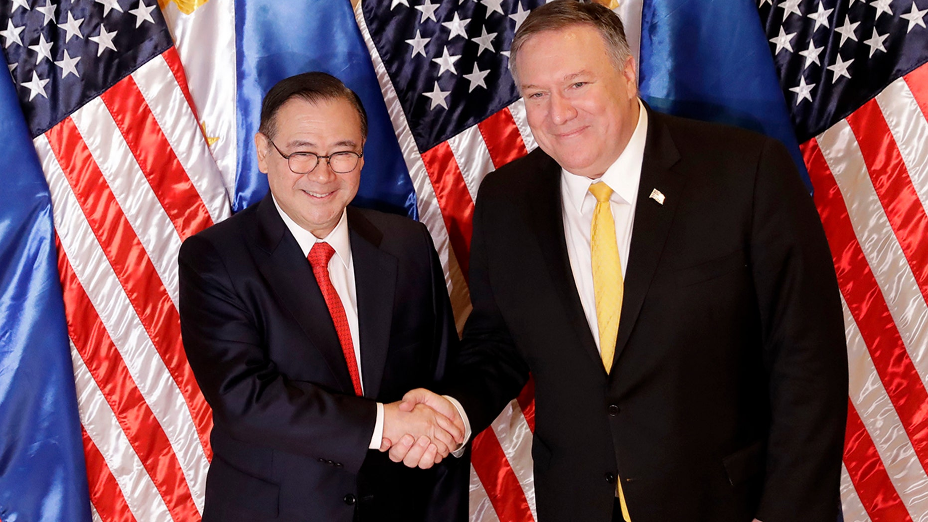 Philippine Foreign Affairs Secretary Teodoro Locsin Jr., left, and U.S. Secretary of State Mike Pompeo shake hands prior to their bilateral meeting in suburban Pasay city, southeast of Manila, Philippines Friday, March 1, 2019. (AP Photo/Bullit Marquez)