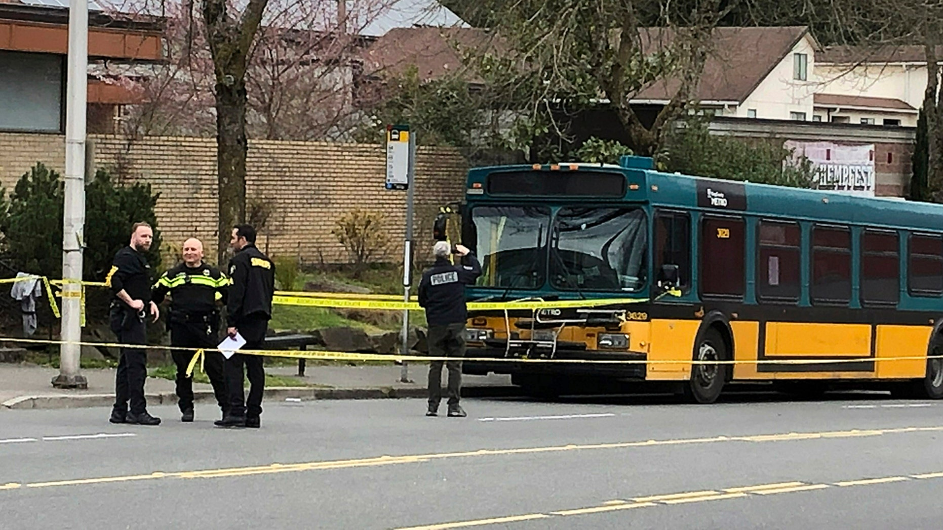 Investigators are working on the scene of a shooting in Seattle on Wednesday, March 27, 2019. (Associated Press)