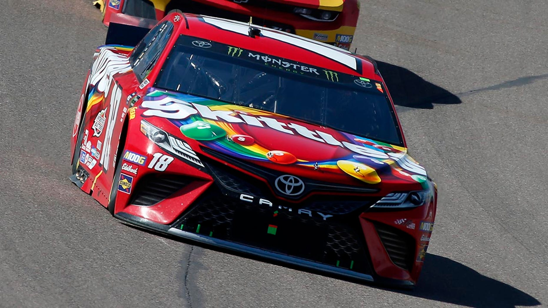 Kyle Busch (18) drives out of Turn 4 during the NASCAR Cup Series auto race at ISM Raceway, Sunday, March 10, 2019, in Avondale, Ariz. (AP Photo/Ralph Freso)