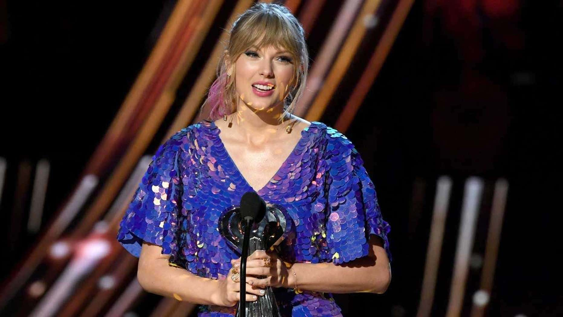 Taylor Swift accepts a Tour of a Year respect during a 2019 iHeartRadio Music Awards.