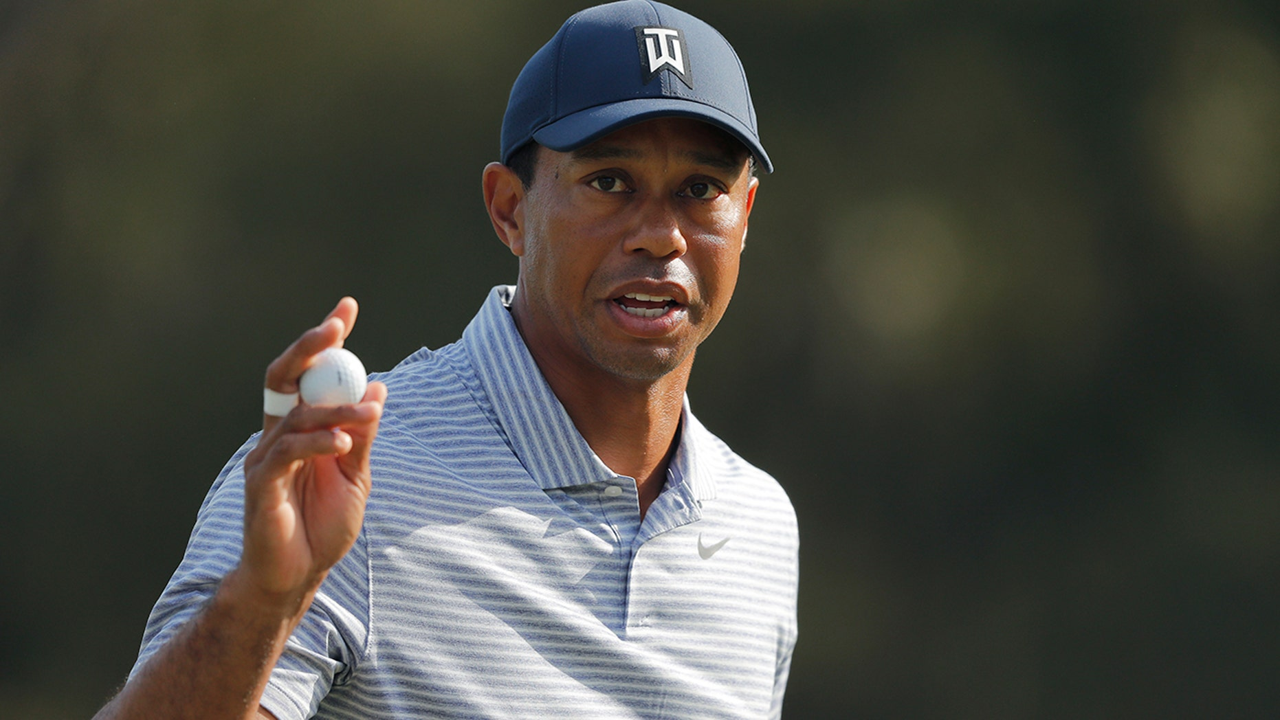 Tiger Woods binds adult his golf turn after putting out on a 14th hole during a second turn of The Players Championship golf contest Friday, Mar 15, 2019, in Ponte Vedra Beach, Fla. (Associated Press)