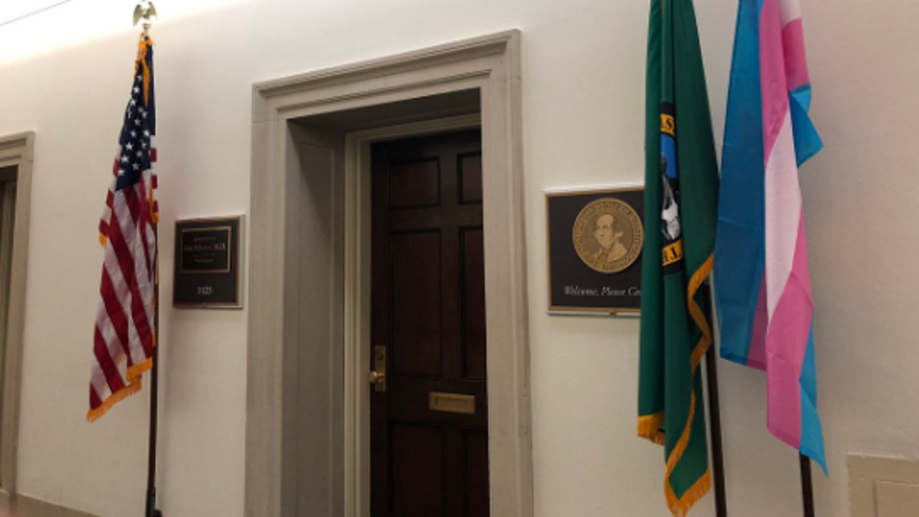 A transgender pride flag, displayed in front of Democratic Rep. Kim Schrier's office.