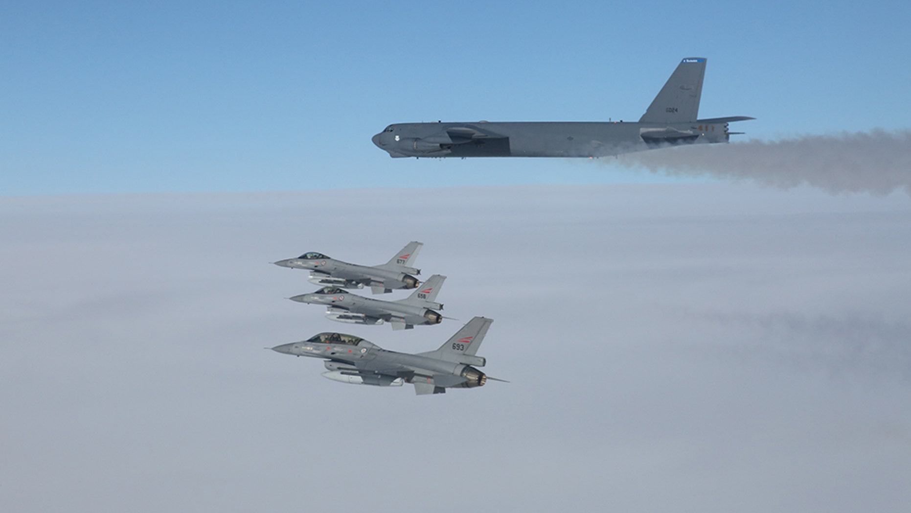 A U.S. B-52 Stratofortresses, deployed from Barksdale Air Force Base, La., flies in formation with three Norwegian F-16 Fighting Falcons over Norway, March 28, 2019.