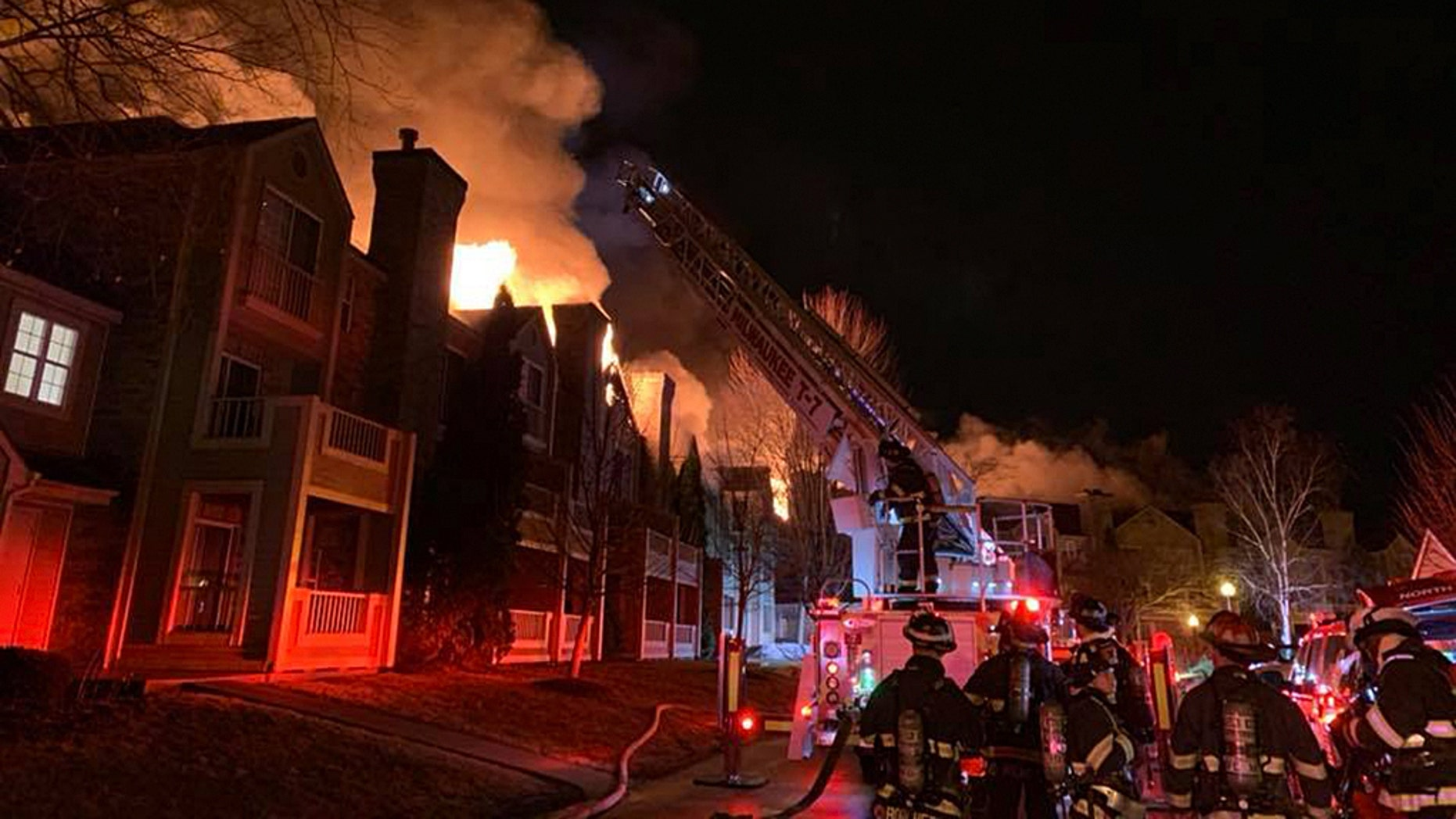 "A Wisconsin apartment building reportedly became engulfed in flames in an overnight blaze and the fire chief said it was ""miraculous"" that all of its occupants are accounted for."