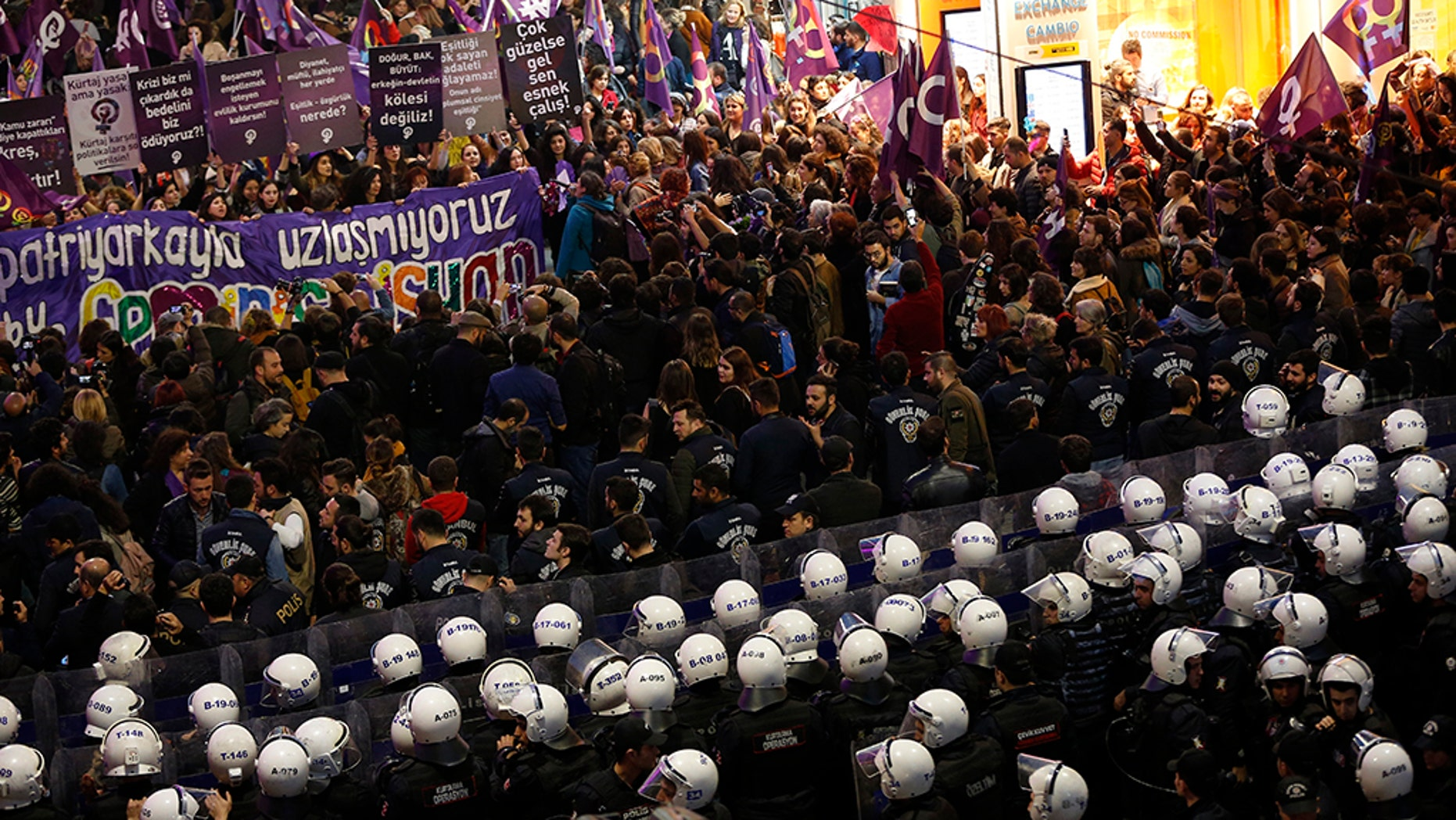 Turkish police block protesters wanting to hold a march for the International Women's Day, at Istiklal street, the main shopping street in Istanbul, Friday, March 8, 2019. The day has been sponsored by the United Nations since 1975 as millions around the world are demanding equality amid a persistent salary gap, violence and widespread inequality. (AP Photo/Lefteris Pitarakis)