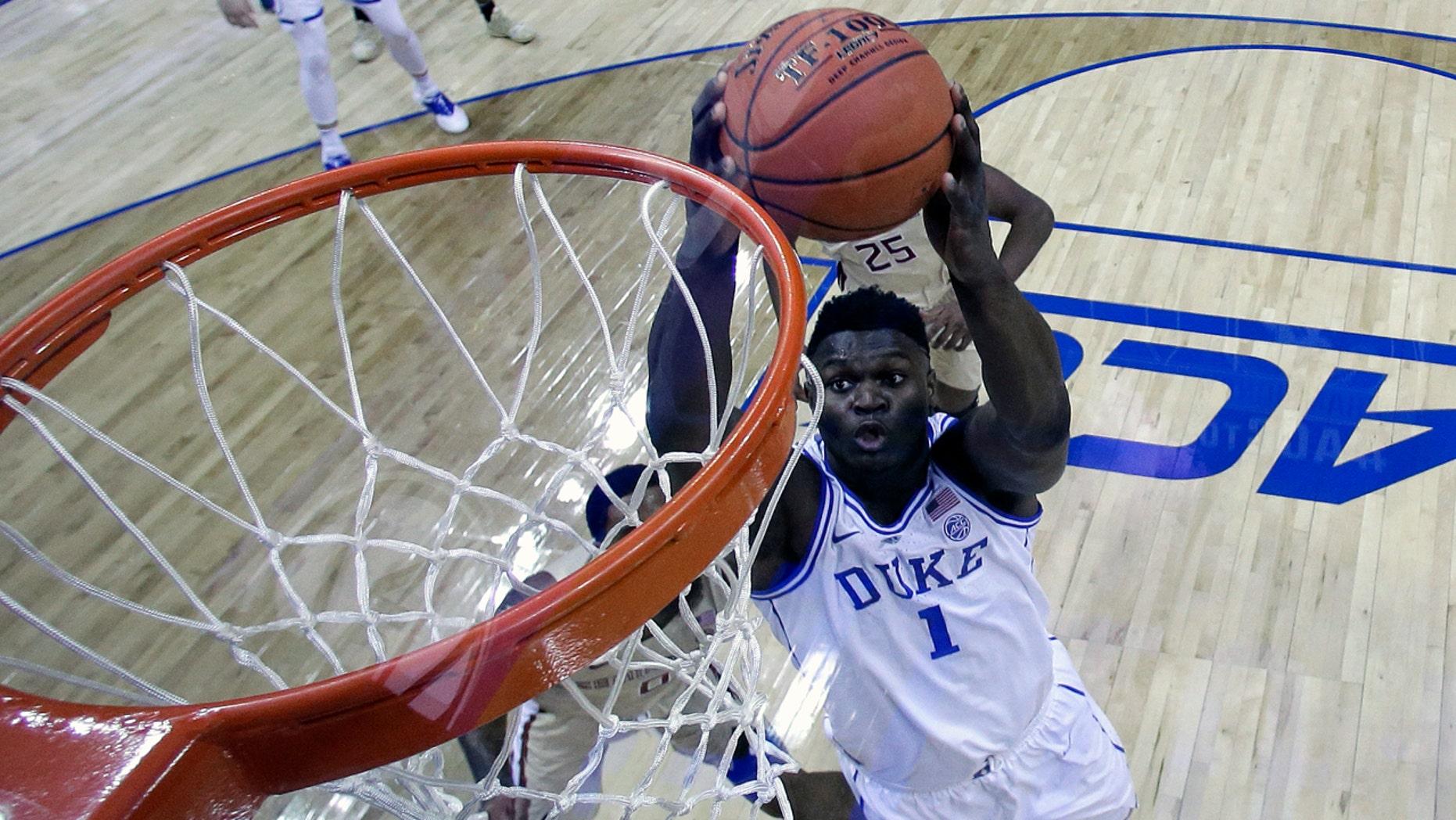 Zion Williamson led Duke to the ACC Tournament title and a No. 1 seed.(AP Photo/Chuck Burton)