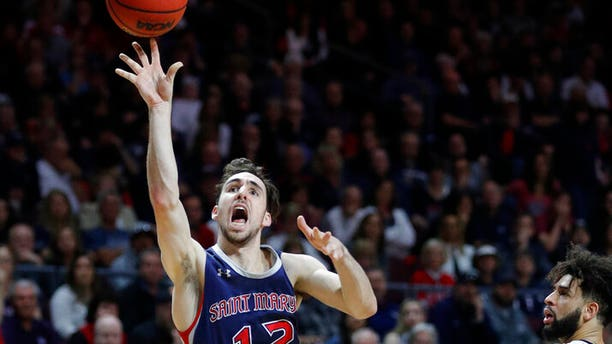 St. Mary's Tommy Kuhse (12) shoots against Gonzaga during the second half of an NCAA college basketball game for the West Coast Conference men's tournament title.