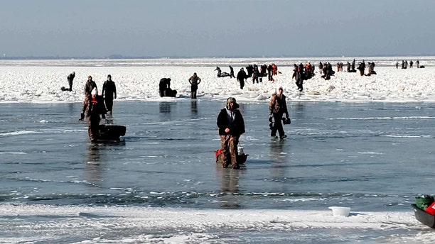 "Some of the ice fishermen made it back to shore ""by swimming or walking on ice-bridges,"" the Coast Guard confirmed."