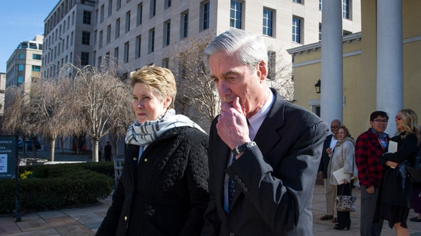 Special Counsel Robert Mueller, and his wife Ann, depart St. John's Episcopal Church, across from the White House, in Washington, Sunday, March 24, 2019. (AP Photo/Cliff Owen)