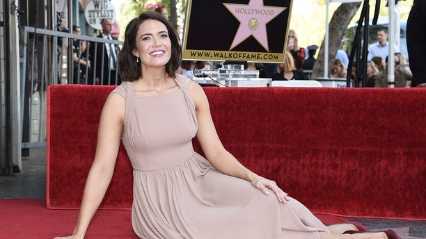 Mandy Moore poses for photographers at a ceremony honoring her with a star on the Hollywood Walk of Fame on Monday, March 25, 2019, in Los Angeles.