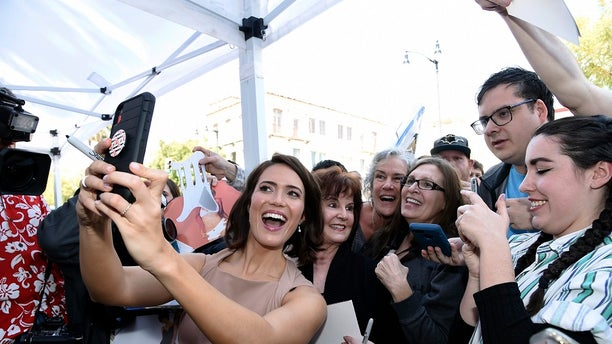 Mandy Moore takes a selfie with fans at a ceremony honoring her with a star on the Hollywood Walk of Fame on Monday, March 25, 2019, in Los Angeles. (AP)