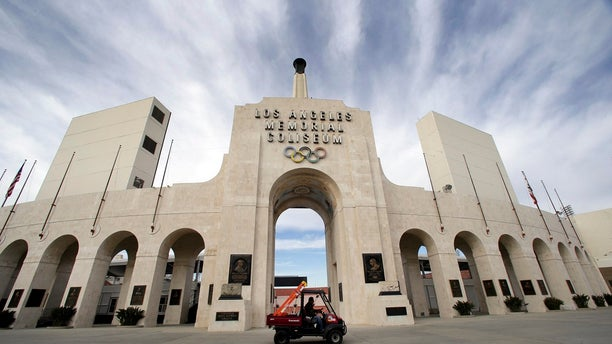 The University of Southern California's sale of naming rights for Los Angeles Memorial Coliseum is being criticized as dishonoring the historic stadium's dedication as a memorial to soldiers who fought and died in World War I. (Associated Press)
