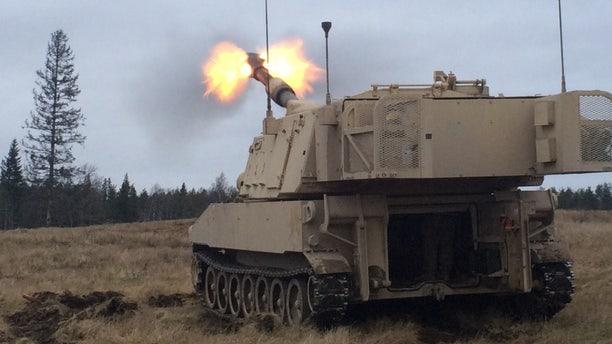 File photo - Artillerymen of 1st Battalion, 41st Field Artillery Regiment fire M109 Alpha 6 Paladins, on Tapa Army Base, Estonia, Nov. 27, 2015. (U.S. Army photo by: Sgt Caitlyn Byrne, 10th Press Camp Headquarters)