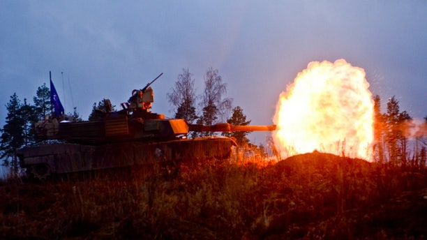File photo - Infantrymen of the 3rd Battalion, 69th Armored Regiment, 1st Brigade, 3rd Infantry Division, fire M1A2 System Enhancement Package Version 2 vehicles on Tapa Army Base, Nov. 13, 2015.