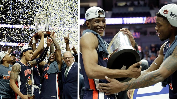 Auburn Tigers celebrate after defeating the Tennessee Volunteersin the championship game of the NCAA Southeastern Conference basketball tournament Sunday, March 17, 2019, in Nashville, Tenn. Auburn won 84-64.
