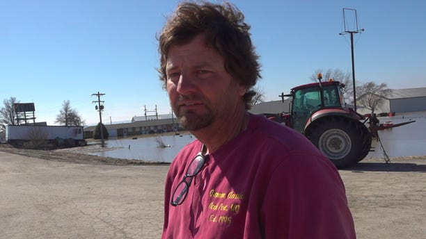 Chad Ottmann surveying the damage to his property after the Missouri River sent water rushing through his businesses. (Fox News/Charles Watson)