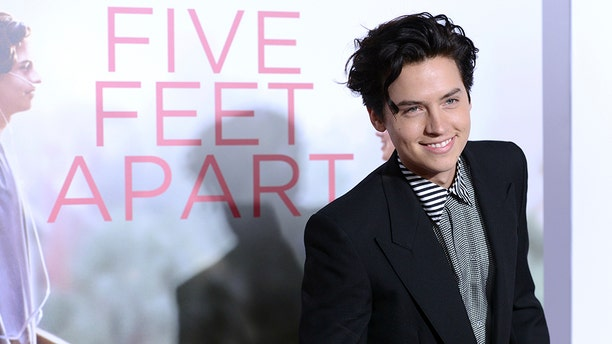 "Cole Sprouse arrives at the Los Angeles premiere of ""Five Feet Apart"" on Thursday, March 7, 2019 in Los Angeles. (Photo by Jordan Strauss/Invision/AP)"