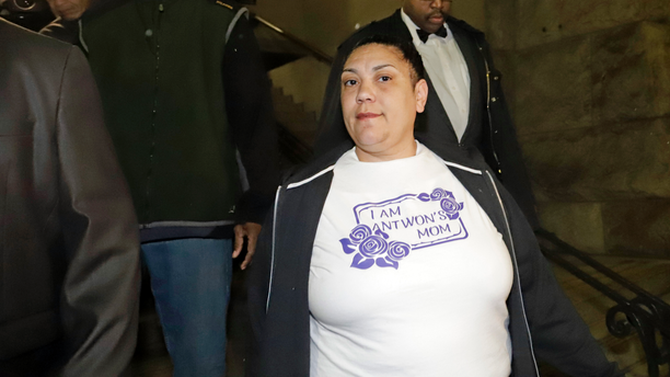 """File-This March 22, 2019, file photo shows Michelle Kenney, center, the mother of Antwon Rose II, leaving the Allegheny County Courthouse with supporters after hearing the verdict of not guilty on all charges for Michael Rosfeld, a former police officer in East Pittsburgh, Pa. Kenney joined friends of supporters at a vigil Sunday, March 24, 2019, at the basketball court in the Hawkins Village housing complex in Rankin, where she lives. """"This was definitely his spot right here,"""" Kenney said. """"If you was looking for Antwon, you'd find him on the basketball court."""" Supporters, she said, put the event together while she was sleeping. (AP Photo/Gene J. Puskar/File)"""