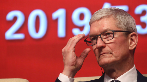 Apple CEO Tim Cook reacts during the Economic Summit held for the China Development Forum in Beijing, China, Saturday, March 23, 2019. (AP)