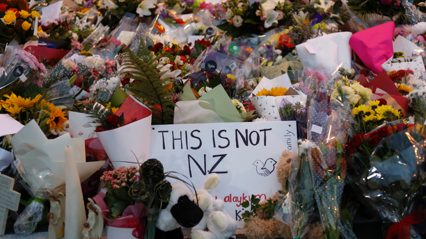 In this Saturday, March 16, 2019, file photo, flowers lay at a memorial near the Masjid Al Noor mosque for victims in last week's shooting in Christchurch, New Zealand. (AP Photo/Vincent Yu, File)