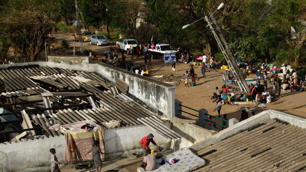 Displaced families set up their bedding on top of the roof in Buzi district, 200 kilometers (120 miles) outside Beira, Mozambique, on Saturday, March 23, 2019. A second week has begun with efforts to find and help some tens of thousands of people in devastated parts of southern Africa, with some hundreds dead and an unknown number of people still missing. (AP Photo/Themba Hadebe)