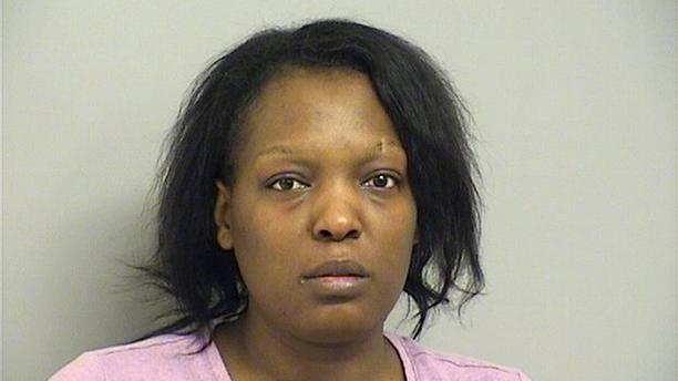 In this Tuesday, March 26, 2019, booking provided by the Tulsa County Sheriff's Department, shows 25-year-old Deionna Young who is being held without bond Tuesday on a first-degree murder charge in Tulsa. Police say Young, an Oklahoma restaurant manager, has been charged with killing an abusive customer, Desean Tallent, after reporting he threatened her, left and then returned. Police say Tallent later returned, but drove off. Young followed and allegedly shot him, then returned to work. (Tulsa County Sheriff's Department via AP)